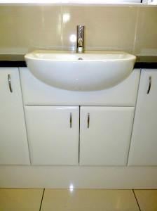 bathroom washbasin and cupboard